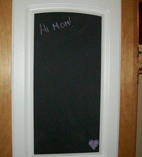 Repurposed cabinet door into a chalkboard