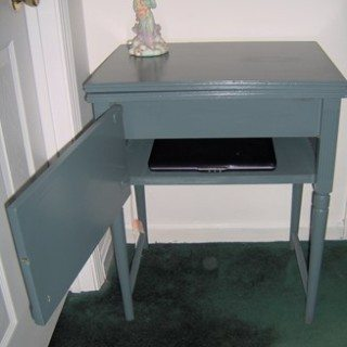 Vintage sewing cabinet now a cute side table