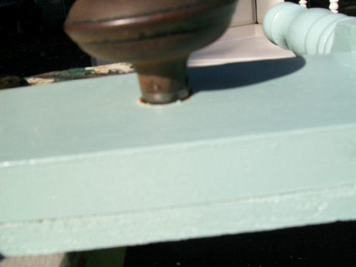 vintage doorknob makes a great hook for headboard coat rack