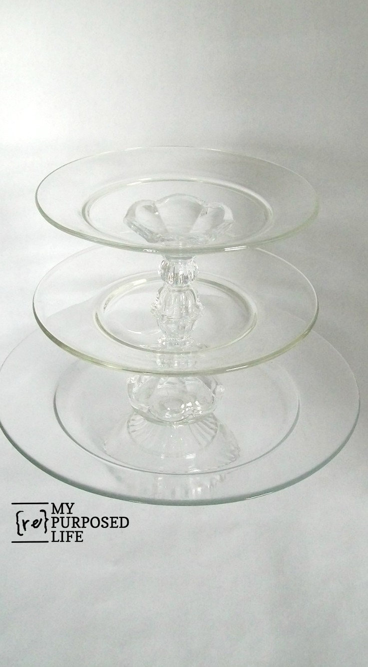 How to make a glasss dessert plate using thrifted items. It's easy to glue the pieces into a pedestal design for yummy cupcakes and more. #MyRepurposedLife #repurposed #glassware #glass #diy #project #cupcakestand #dessertplate #thrifted via @repurposedlife