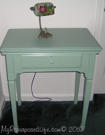 An old beat up vintage sewing table side table. This easy makeover will give you an idea of what you can do. Sometimes, all you need is a little elbow grease and paint. The sewing table before the makeover will shock you! They also make great nightstands. #MyRepurposedLife #repurposed #furniture #sewingtable #sidetable #easy #makeover via @repurposedlife