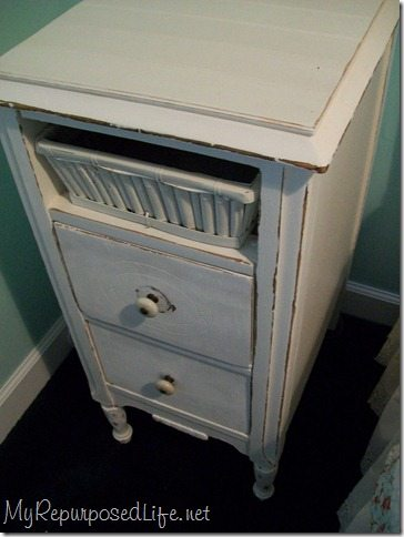 An old nightstand gets a new chance with paint, hardwood flooring and a basket. How to deal with bad veneer for the top and the drawer. Lots of tips! #MyRepurposedLife #repurposed #furniture #nightstand #makeover via @repurposedlife