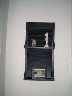 small repurposed shutter shelf