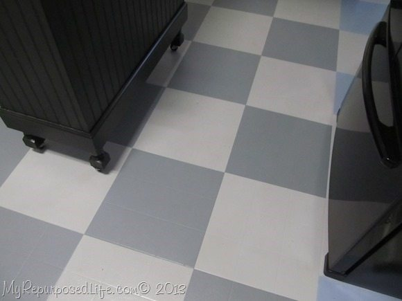 How i painted my vinyl floor my repurposed life for Can you paint over vinyl flooring