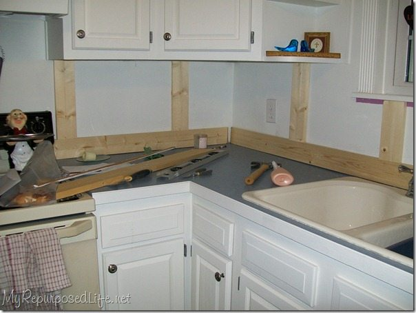 Board and batten back splash my repurposed life for Board and batten kitchen cabinets
