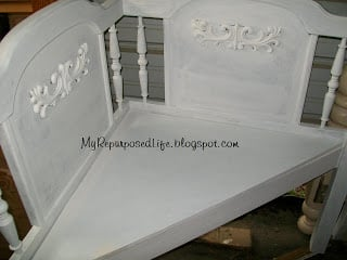 white corner bench made from a full headboard