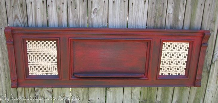 red piano with sheet metal inserts