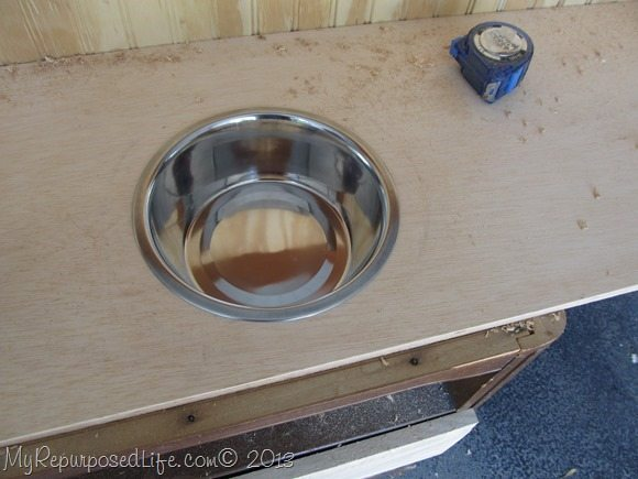 drop the pet bowl into the hole