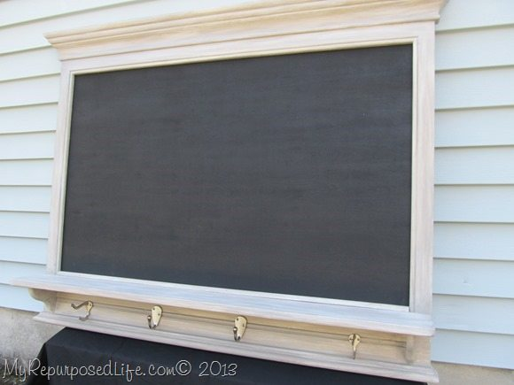 large chalkboard with shelf and hooks