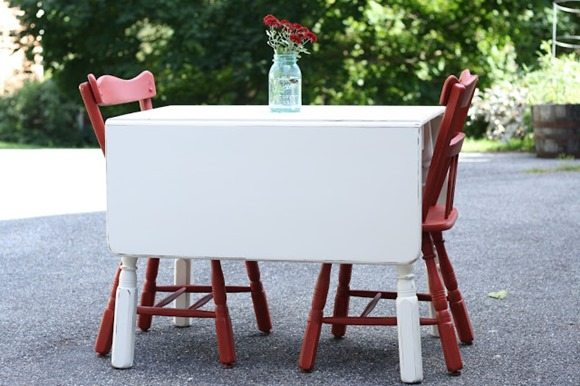 vintage white table red chairs