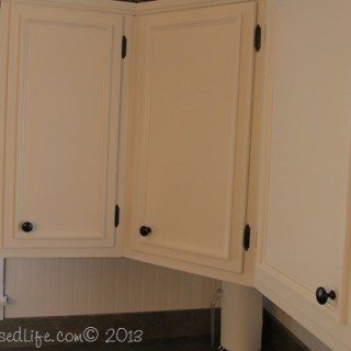 Kitchen Cabinets Updated with Paint & Trim