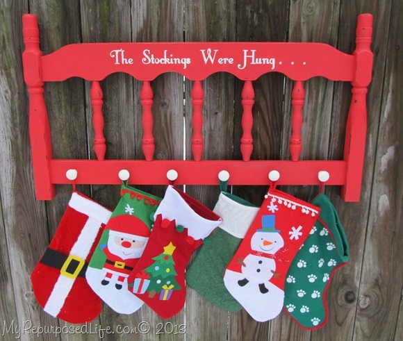 Repurpose an Old Headboard and add inexpensive ceramic knobs as a Stocking Hanger - Tutorial via My Repurposed Life