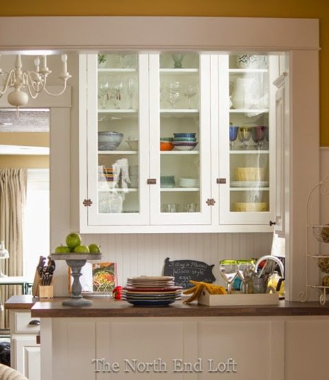 white kitchen reveal with vintage hutch