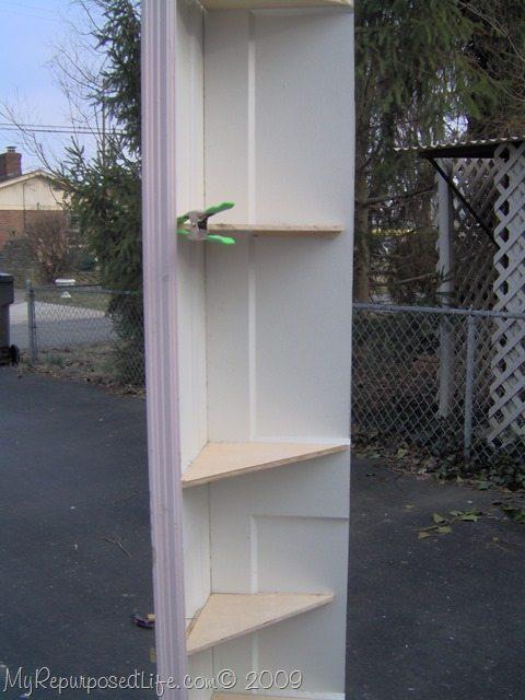adding shelves to repurposed door corner shelf