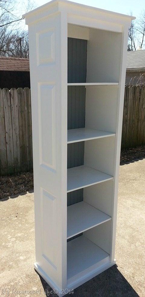 Bi-fold doors are easily found at ReStores at a great price. I used 2 to make this bi-fold door bookshelf. Easy weekend project using bi-fold doors. #MyRepurposedLife #repurposed #upcycled #door #bookshelf via @repurposedlife