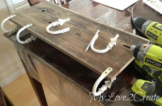 attaching curtain tie backs to shelf board to make hooks