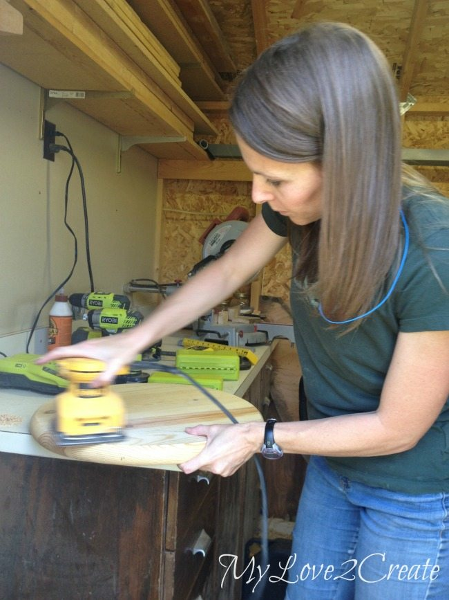 sanding round pine panel