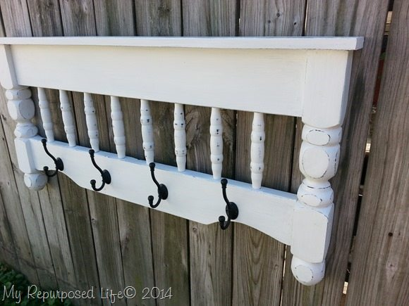 repurposed bunk bed into a great coat rack shelf