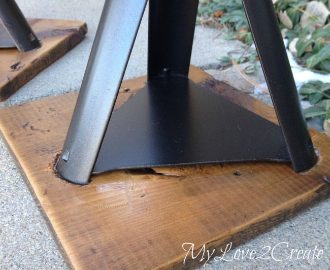 close up of rustic industrial chair base
