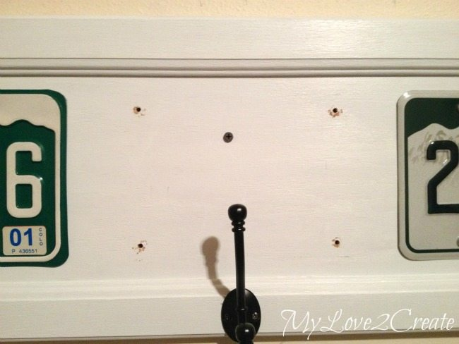 attaching to wall with screw drilled into stud