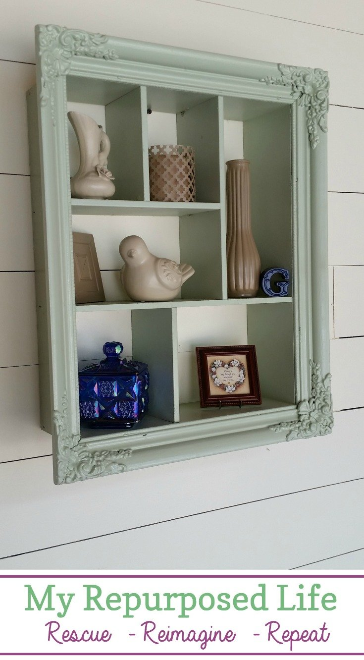 How to use an ornate picture frame and drawer pieces to make a divided shadow box that can be hung on the wall four different ways. Step by step directions to help you do it yourself.  Adding spray painted thrift store decor items makes this a fun and frugal project. #MyRepurposedLife #thrift #pictureframe #repurposed #shadowbox  via @repurposedlife