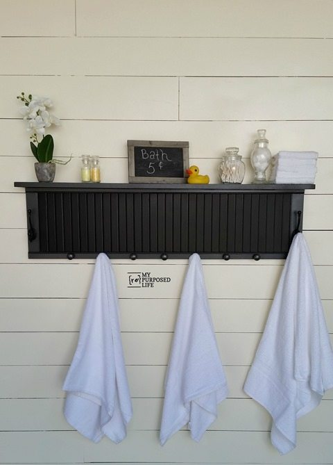 How to use a shutter or half of a bi-fold door to make a shutter shelf with hooks. Easy project, great tips to make it a fun afternoon project. Perfect for the kitchen, mudroom, guest room, or bathroom. #MyRepurposedLife #repurposed #shutter #shelf #hooks #mudroom #bathroom #guestroom #kitchen  via @repurposedlife