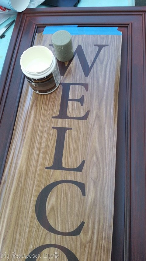 contact paper stencil to make an easy welcome sign