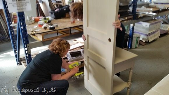 attach antique door to small table to make a great hall tree