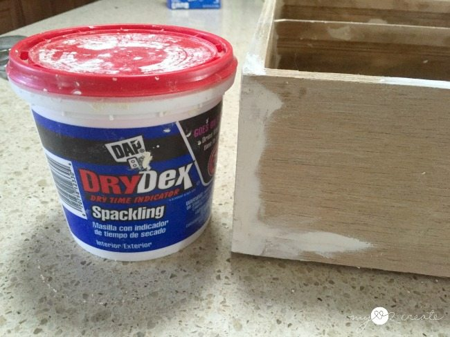 filling holes in drawer with spackling