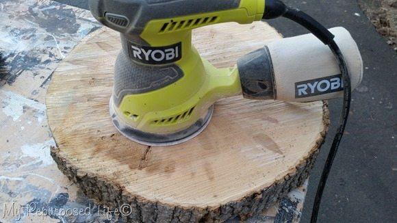 sanding wood slice