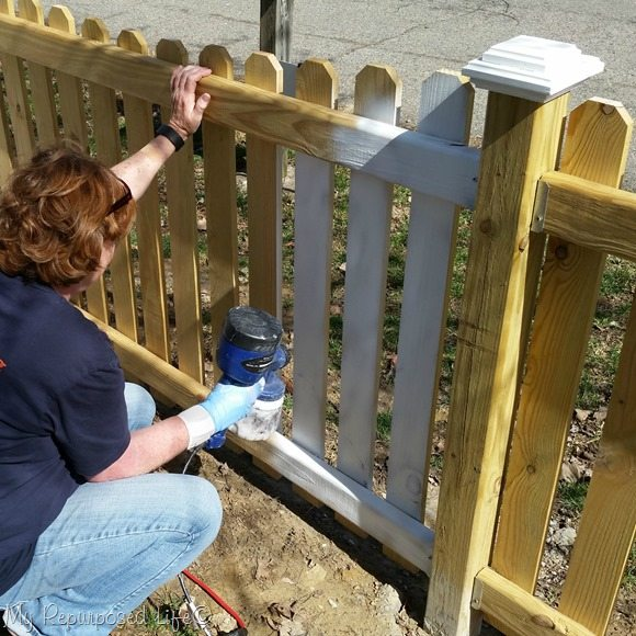 using a finish max to paint a picket fence or other home imrpovement projects MyRepurposedLife