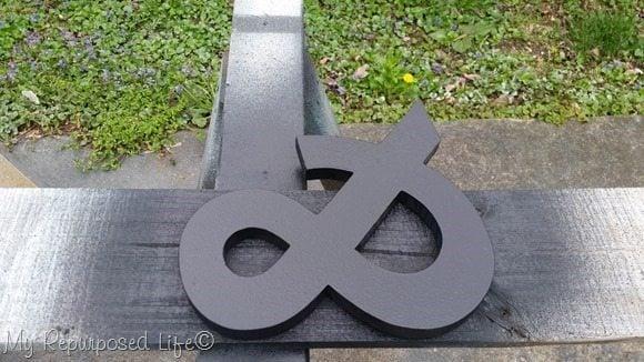 black wooden ampersand symbol