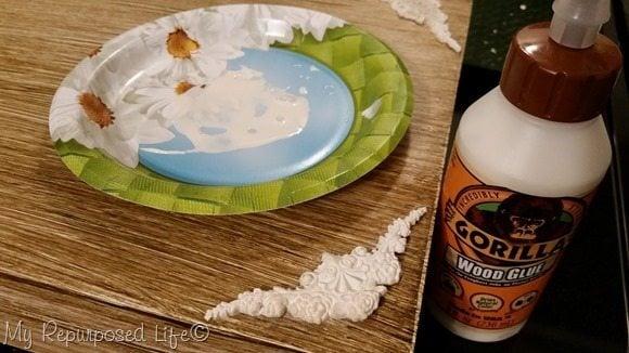gorilla wood glue secures paper clay appliques