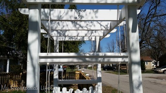 hanging gutter planters on the arbor