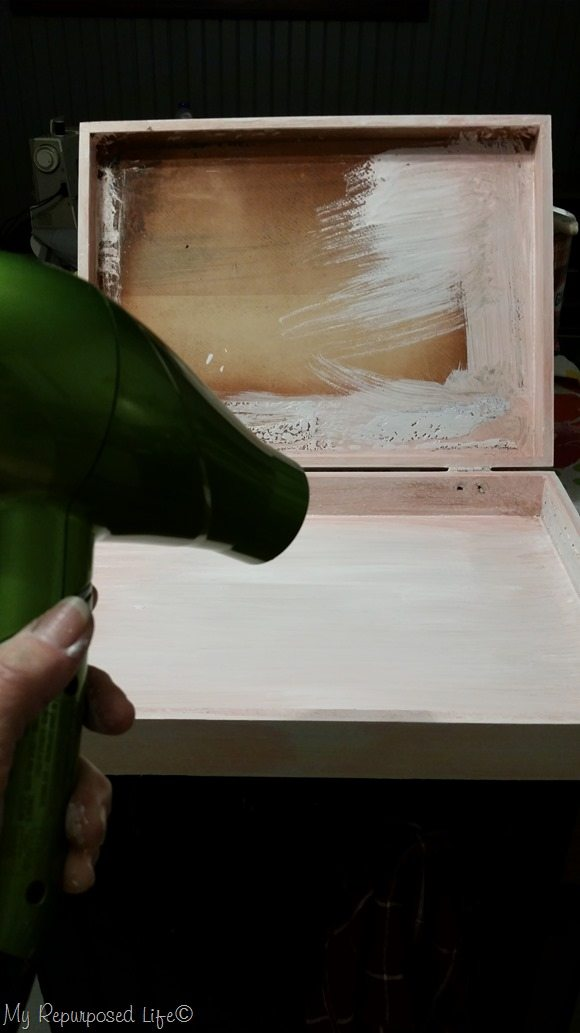 using a hair dryer to dry painted project