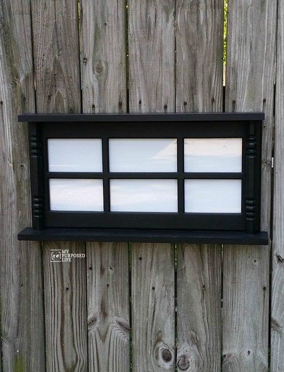 repurposed glass hutch door as a picture frame wall shelf myrepurposedlife.com