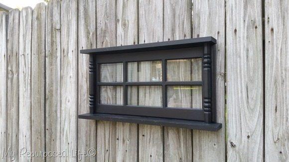 wall shelf made with glass hutch door and more MyRepurposedLife.com