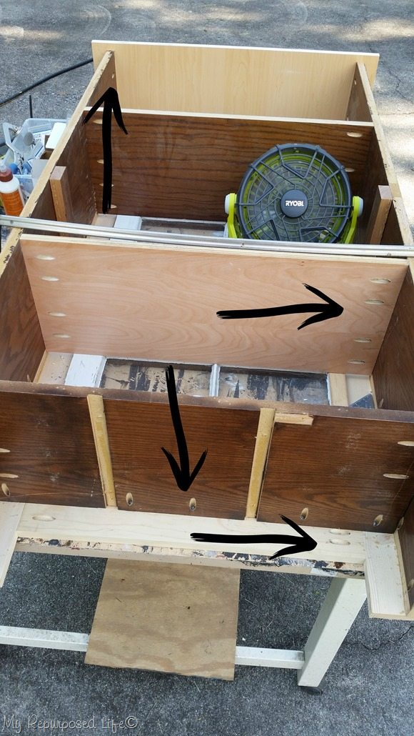 attaching-shelves-cupboard