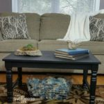 black-coffee-table-makes-a-great-bench-for-extra-seating-made-from-chair-legs-and-hardwood-floor.jpg