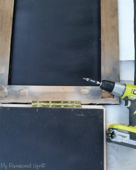 repurposed coffee table chalkboard easel piano hinge