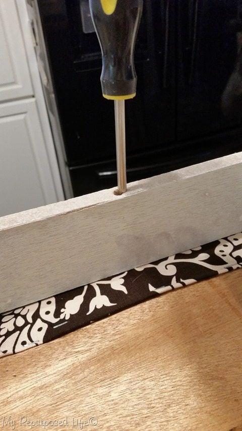 secure footstool top