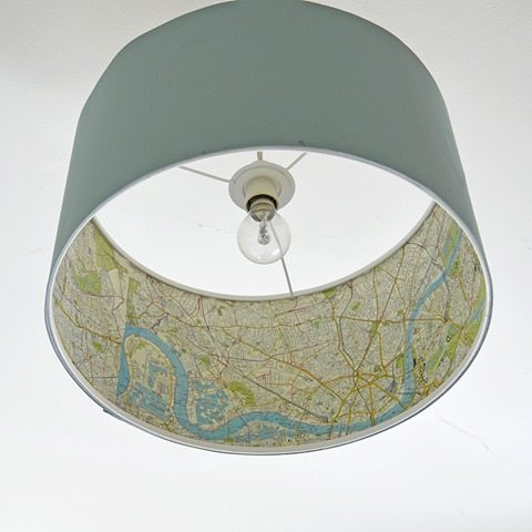 Ikea hack with map pages on a lamp shade - featured at Knick of Time - www.KnickofTime.net