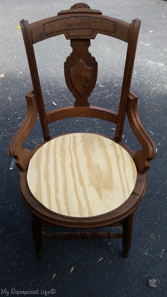 antique cane chair gets a new wooden seat