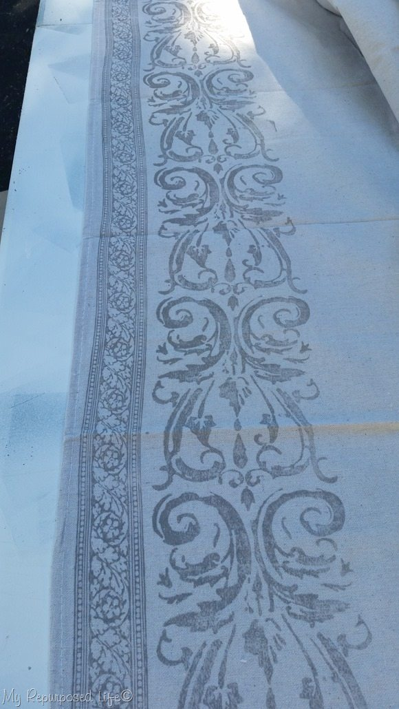 drop cloth curtain with roller stamp design painted on