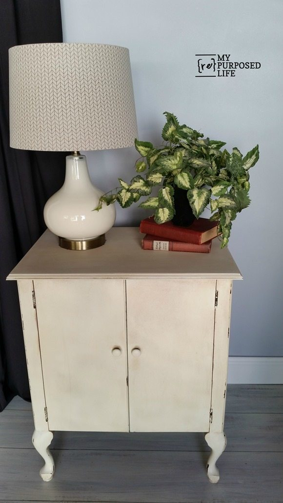 white entry way side table made from an old sewing machine cabinet MyRepurposedLife.com