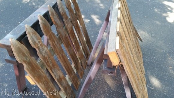 cut off section of picket fence coat rack