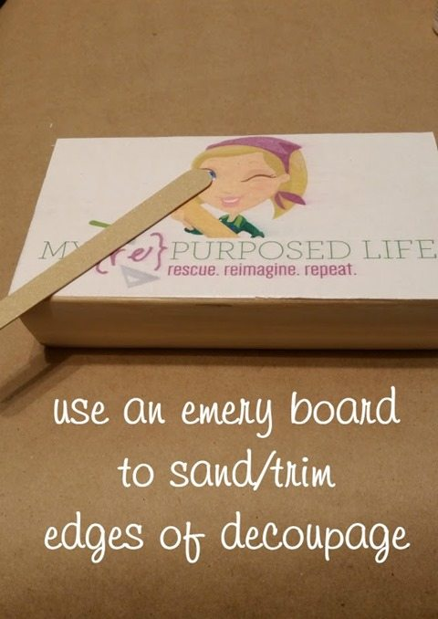 use emery board on decoupage wooden desk plaque