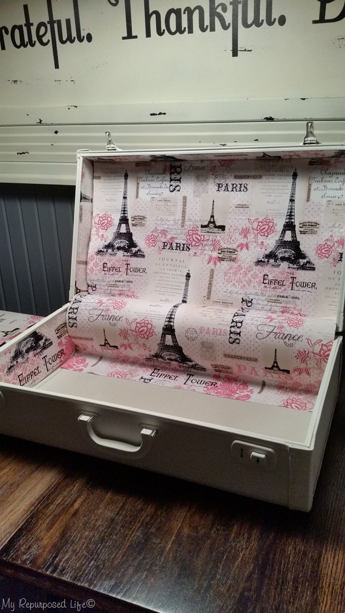 glue vintage suitcase lining in place