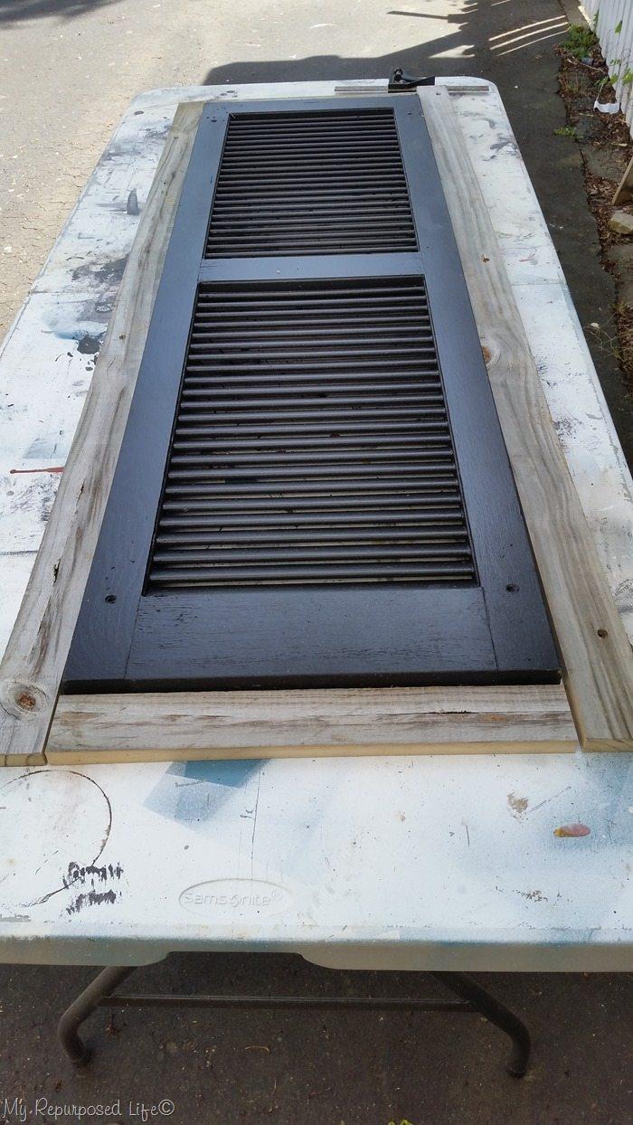 rustic shutter cabinet design stage