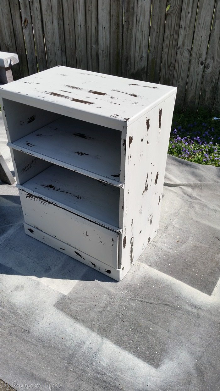 wipe back paint reveal a great finish on chippy white chest